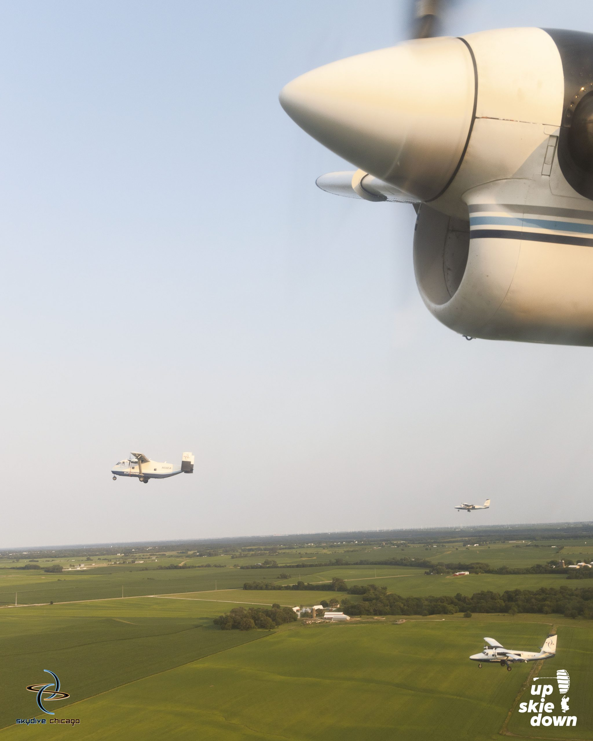Skyvan and two Twin Otters coming in for landing after launching successful All American 80 Way